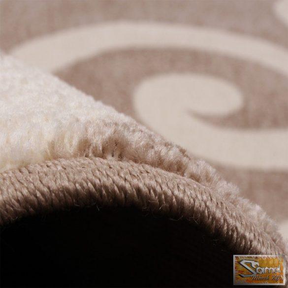 Barna szőnyeg krém mintával