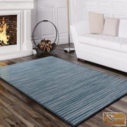 Türkiz szőnyeg, csillám fonalakkal